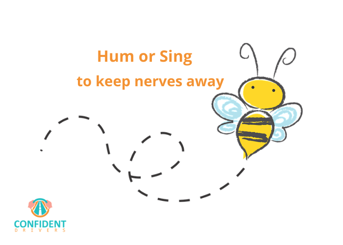 hum or sing to calm test nerves